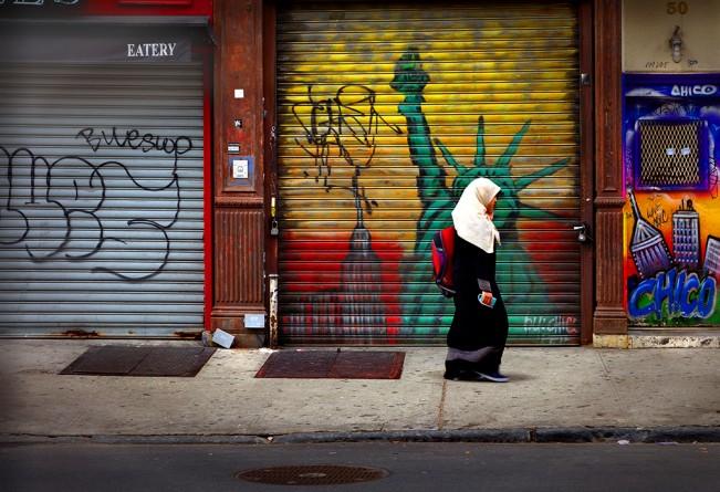 Woman walking down Ave B. NYC