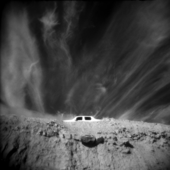 Passing Car on a Cliff Road