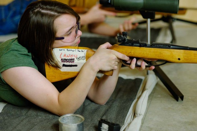 Jenna Lanou, member of the Rifle Team, shooting a match.