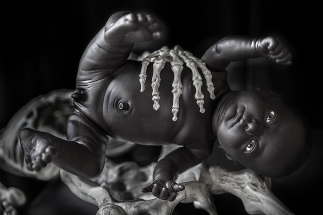 Baby with Skeleton Hand