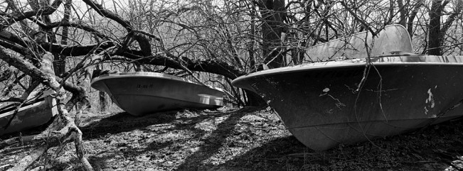 Discarded boats sit deep in the woods near Utica, Indiana.