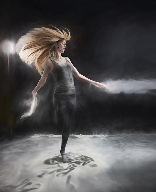 Dancing woman with long blonde hair