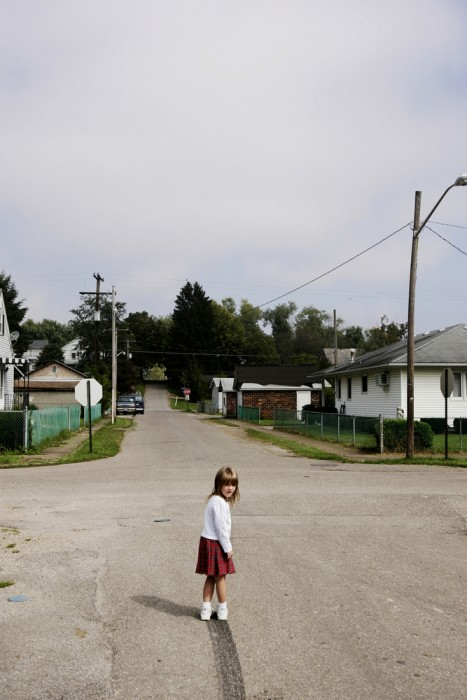 Lacey Sellers wanders out in the middle of the street to examine the skidmark her daddy left as he drove away. She and her identical twin Kacey were both born deaf and live in the impoverished town of Chauncey, Ohio.