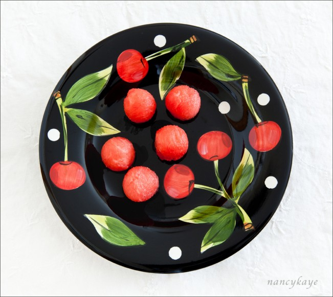 """Melon Balls on Cherry Plate"""