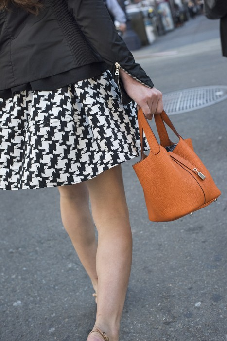 Lady with Orange Handbag