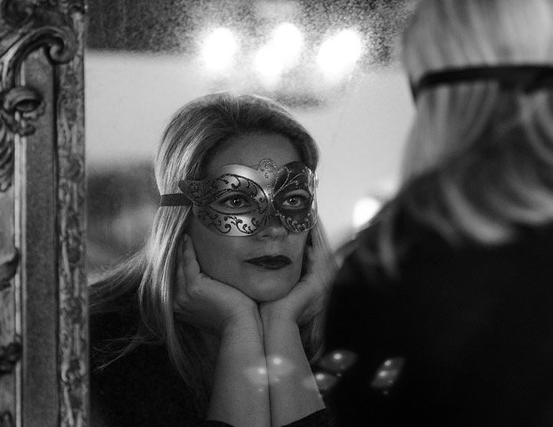 Masked Woman in Mirror