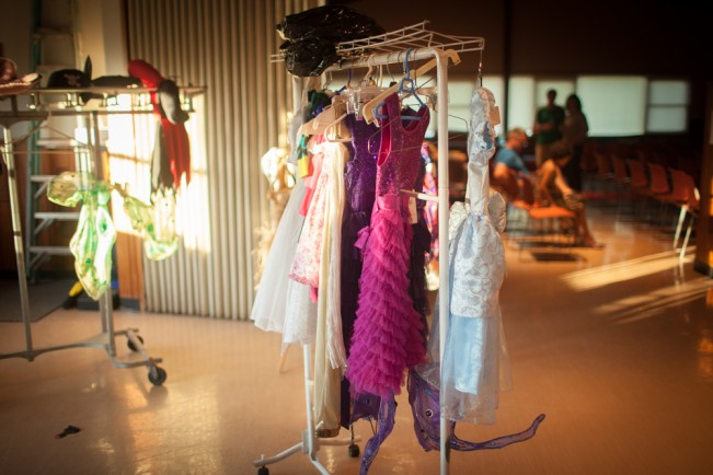 Outfits and accessories are hung in preparation for the fashion show.