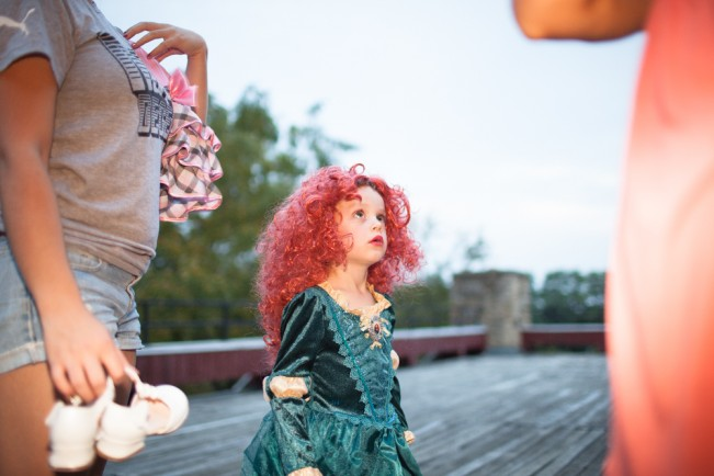 Parents assist younger campers with costume changes.