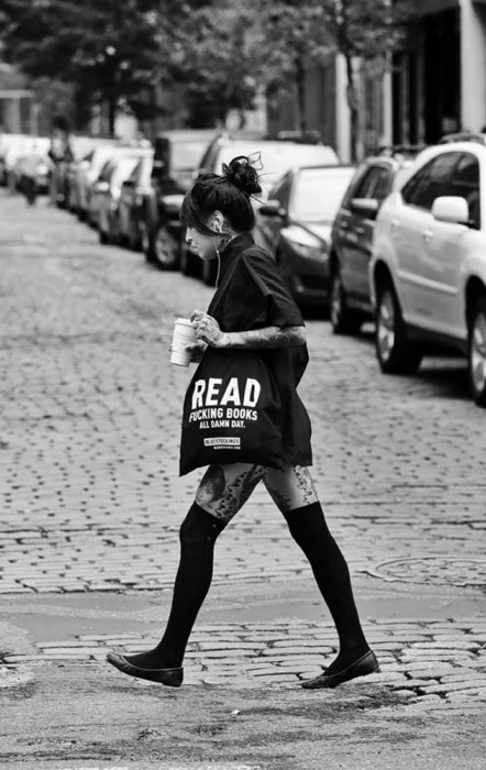 Reading Series--Woman with book bag that reads: READING FUCKING BOOKS ALL DAMN DAY crosses Prince & Wooster in Soho, NYC. July 18, 2015 exclusive photo by Lawrence Schwartzwald
