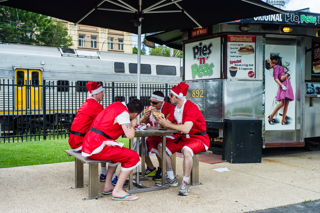 Santa Claus- performer have a break with humburgers