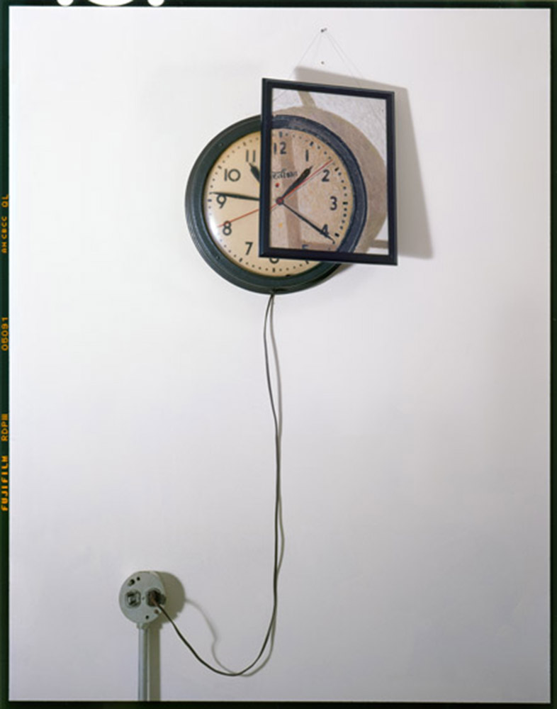 Clock, Outlet and Painting on Wall