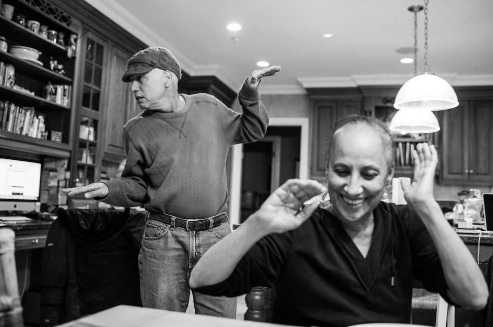 In the kitchen, Howie breaks into a bouncing dance to try and get a smile out of his wife, Laurel. They often turned to humor to lighten the heavy mood in the home. Chappaqua, New York. February, 2013.