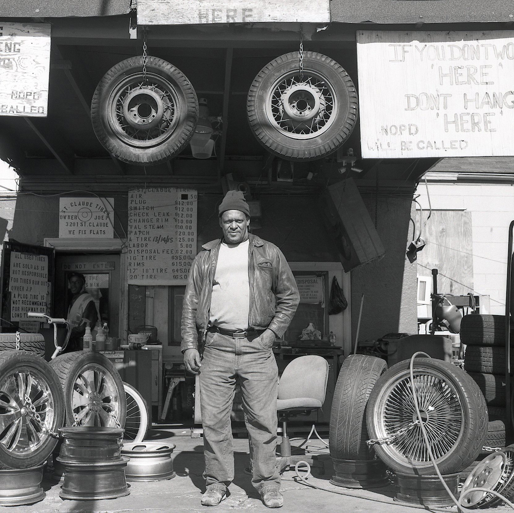 12.man working at a tire repair shop, saint claude avenue, new orleans