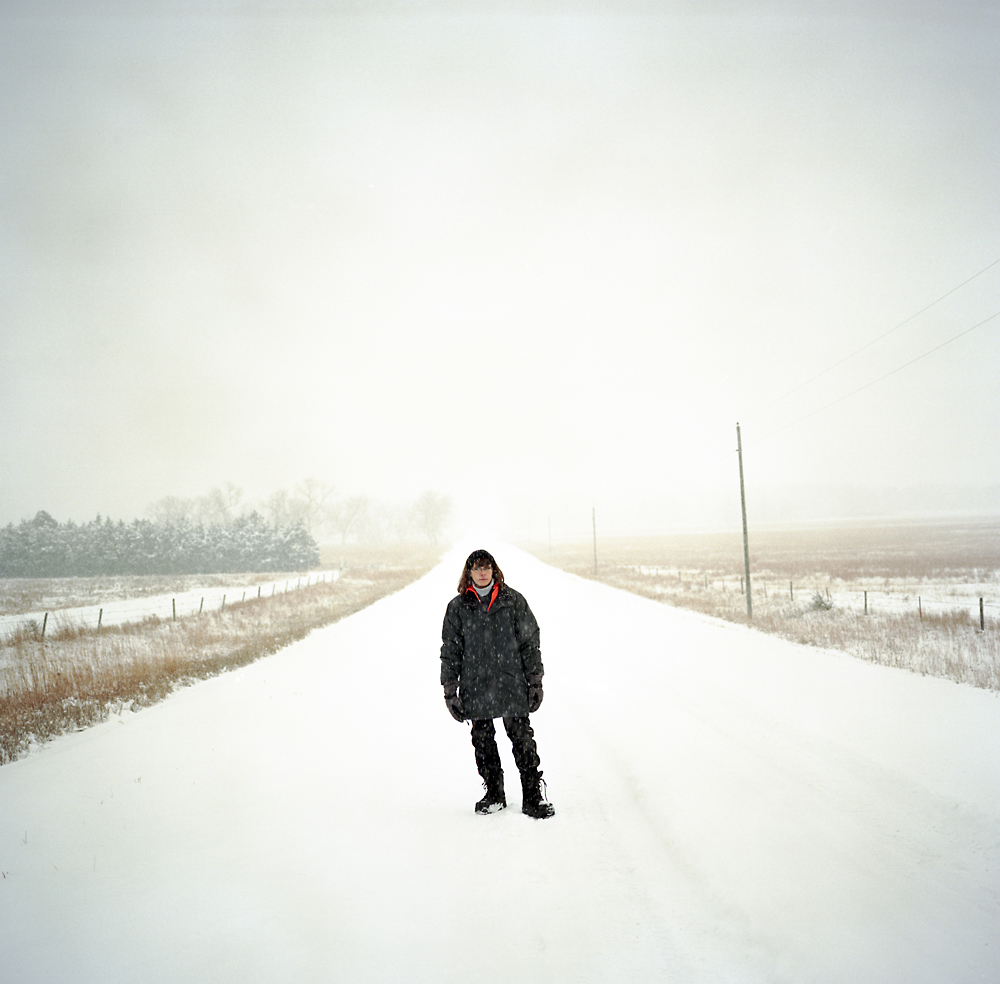 Jeanne Kilmurry stands in the road in front of her family's property near Atkinson, Nebraska where the Keystone XL pipeline would enter their land.