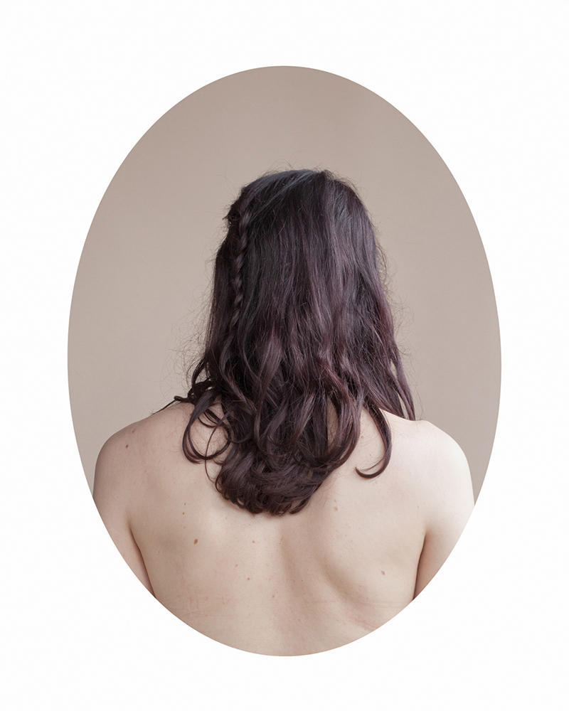 """a modern hair study"" consists of portraits of young women photographed from behind.  By focusing on the back, the viewer is forced to contend with all of the peripheral things that make each woman unique."