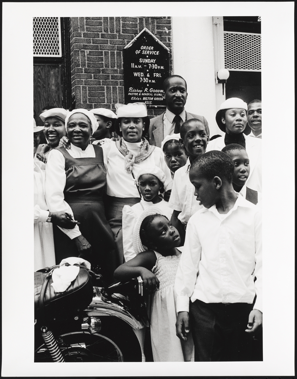 African-American congregation in front of church.
