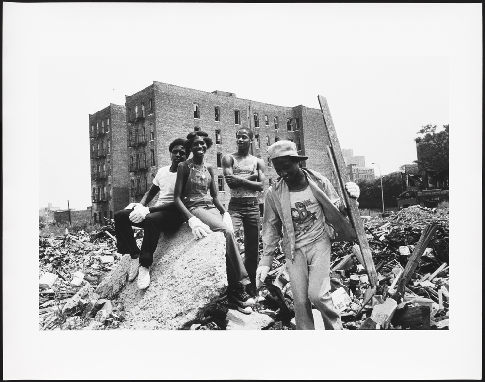 Teens clean up the rubble in order to create a neighborhood gard