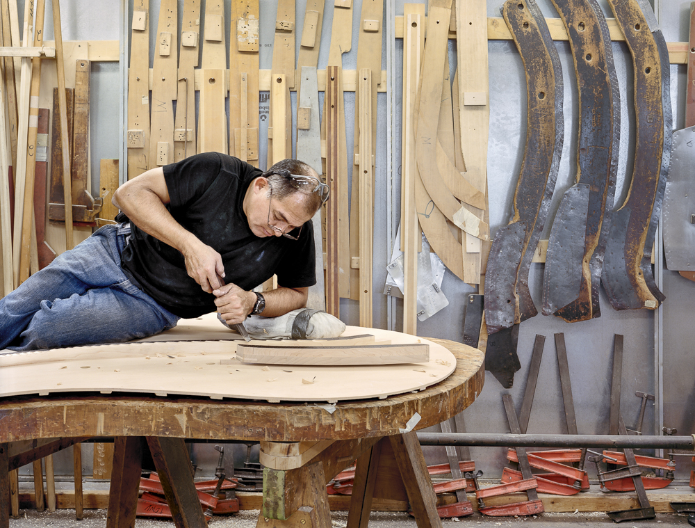 "Galo Torres, ""bellyman"", notching the bridge on a soundboard (Steinway & Sons piano factory, Astoria, NY)"