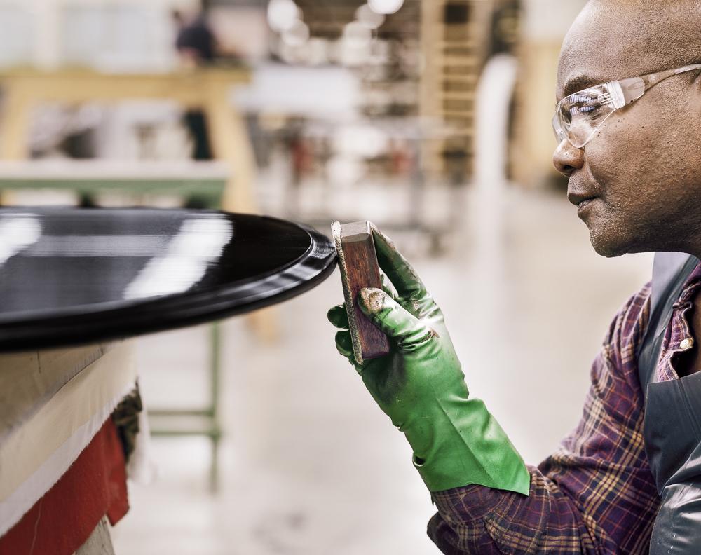 Eddy Senat finishing a lid (Steinway & Sons piano factory, Astoria, NY)