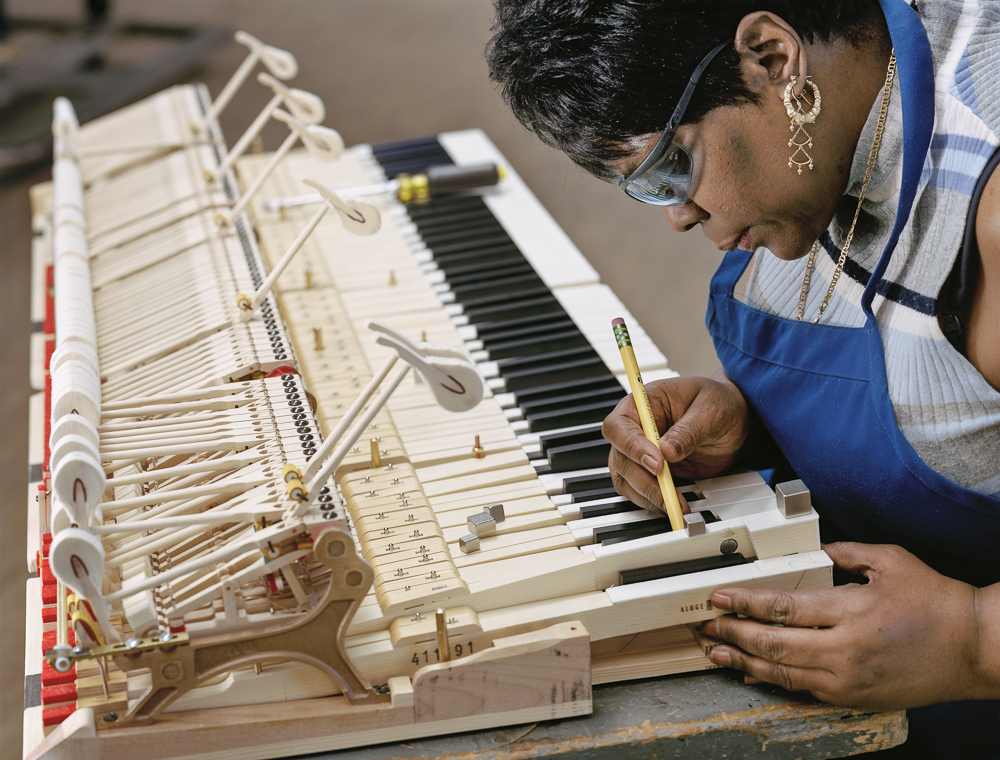 Gwendolyn Folk, key balancing (Steinway & Sons piano factory, Astoria, NY)
