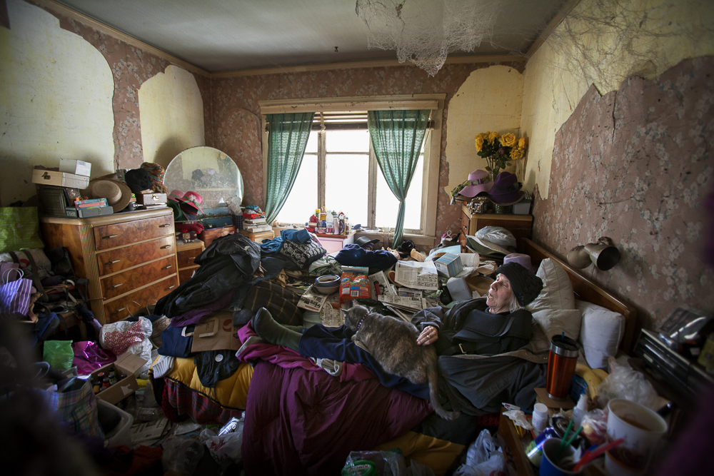 Lee in her bed. When this room became too cluttered to be safe, Lee's son moved her into another room in the house.