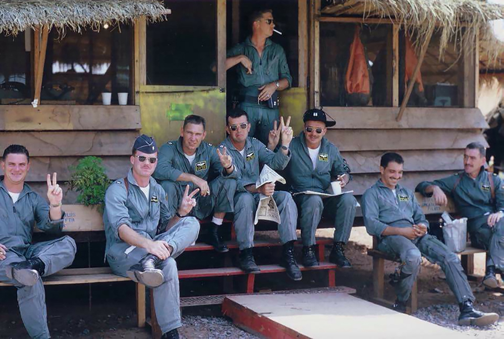Image 07 John MorrisseyTHE PILOTS L-R, Capt. Tom Boatman, 1st Lt John Morrissey, Capt. Charlie Copin, Capt. Matt Kelch (Hit hard coming off a target - 50 miles directly North of Hanoi and ejected in Northern Laos - recovered), 1st Lt. Sam Waters, (took a SAM head on in '67 KIA), Capt. Ray Moss, 1st Lt. Frank Tullo (Shot down during the 27 July SAM site mission, the only one recovered), Major Bill Hosmer. Photo taken two hours prior to the takeoff for the first mission of Rolling Thunder on March 2nd, 1965KORAT ROYAL THAI AIR BASE, THAILANDPhotographer Unknown - Photo provided by:John MorrisseyColonel U.S. Air ForceVietnam 1965 – 1973, Retired 1985