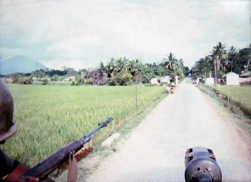 Image 23 Richard BerganGOING ON A MISSION WITH BLACK VIRGIN MOUNTAIN IN VIEW ON THE LEFTCAMBODIARichard BerganArmy, Cpl., 25th Infantry 3rd BattalionVietnam March – October 1966