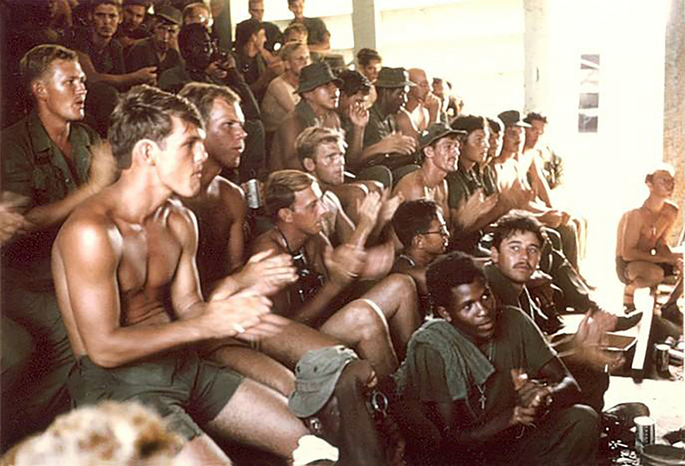 Image 25 Michael Patrick EltrichMEN IN MY PLATOON ON A STAND DOWN WATCHING ENTERTAINMENT AT THE AMERICAL DIVISION'S BASE CAMPCHU LAI, VIETNAM JUNE 1970Michael Patrick EltrichE-4, Company B, 1st Battalion/52nd Infantry, 198th Light Infantry Brigade, Americal DivisionVietnam October 1969 – October 1970