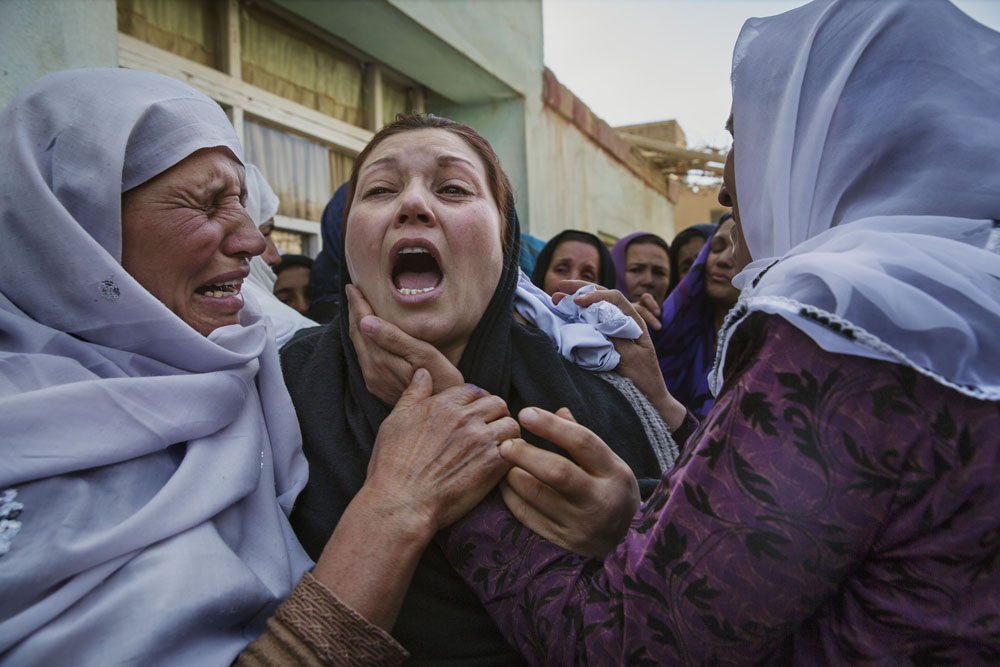 Kabul, March 22, 2015. Relatives, friends, and women's rights activists grieve at the home of Farkhunda Malikzada, who was killed by a mob in the center of Kabul. Farkhunda was violently beaten and set on fire after a local cleric accused her of burning a Qur'an.