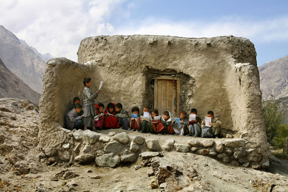 Northeastern Afghanistan, September 2, 2007. Students recite prayers in a makeshift outdoor classroom in the Wakhan Corridor, a mountainous region in northeastern Afghanistan that extends to China and separates Tajikistan from India and Pakistan.