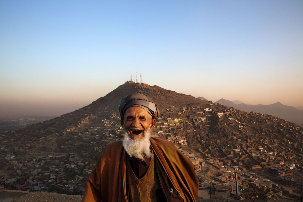 November 21, 2014. Eid Muhammad, seventy, overlooking the hills of Kabul. Millions of Afghans, however, live in informal settlements occupied without a formal deed.