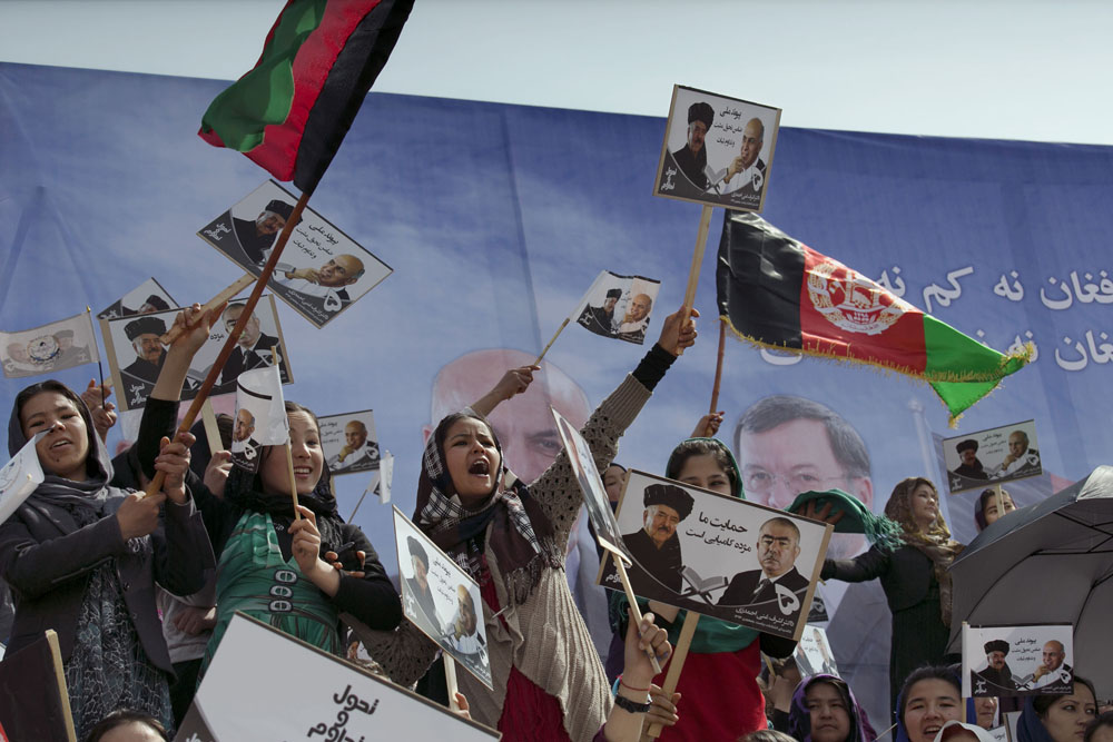 Kabul, April 1, 2014. Young women cheer as they attend a rally for the Afghan presidential candidate Ashraf Ghani.