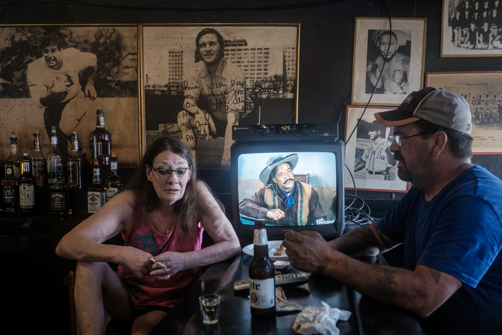 Bartender, Lisa Nicely, talks with West Aliquippa resident Chuck Forrester in Mahoney's West bar in West Aliquippa, PA. Mahoneys has been in operation in West Aliquippa for 40 years, but it closed in 2016 when the owner became sick and unable to continue operations.