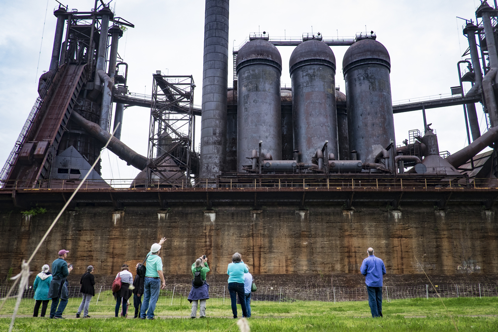 A former steel worker guides site seers on the grounds of the former Carrie Furnaces in Rankin, Pa. The furnaces were built in 1881 as part of U.S. Steel's Homestead Works, a sprawling 400-acre complex that spanned both sides of the Monongahela river. They produced up to 1,250 tons of steel a day until 1978 when they were closed.  While the majority of the site was razed for a shopping center, the 100-foot high furnaces still stand. They are an extremely rare example of pre-WWII ironmaking technology.  The furnaces were designated as a national historic landmark in 2006 and preservation efforts are underway.