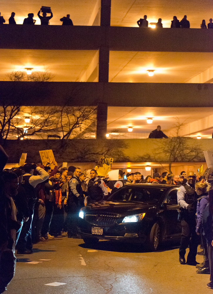 Donald Trump supporters drive away from the UIC Pavilion in Chicago following the cancellation of a scheduled rally on March 11, 2016.