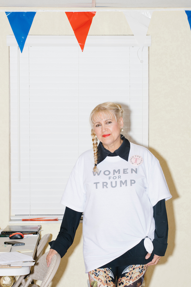 "Wearing a ""Women For Trump"" shirt, Blanca Vrotsos, 62, of Doral, Florida, has been volunteering almost everyday for 10 months at the Donald Trump campaign office in Hialeah, Miami, Florida. She helps recruit volunteers, register people to vote, and train other volunteers. Originally from Cuba, she has been a US citizen for 15 years and says she is ""extremely Republican."" She first voted in 2000 and voted for George W. Bush. She says she will always support the Republican nominee for president."