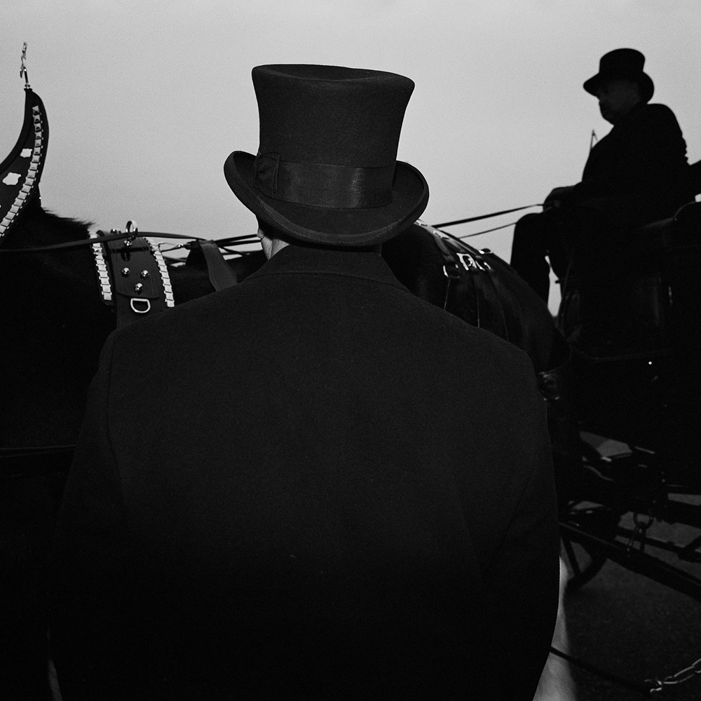 """The driver of the horse drawn carriage carrying the casket with the remains of  """"Mayor For Life"""" Marion Barry in the Washington Highlands neighbourhood before he is driven through all 8 Districts in the city, Washington DC, USA. (Credit Image: © Louie Palu/ZUMA Press)"""