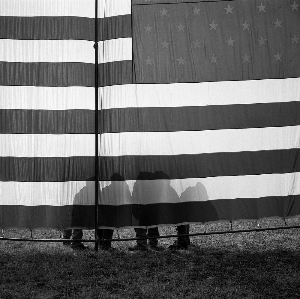 Vietnam Veterans standing by an American flag on the National Mall on Memorial Day, Washington DC, USA. (Credit Image: © Louie Palu/ZUMA Press)