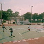 Goodman League operations employees clean the court after a rain shower. The court was refurbished not too long ago with a $50,000 donation from Nike.
