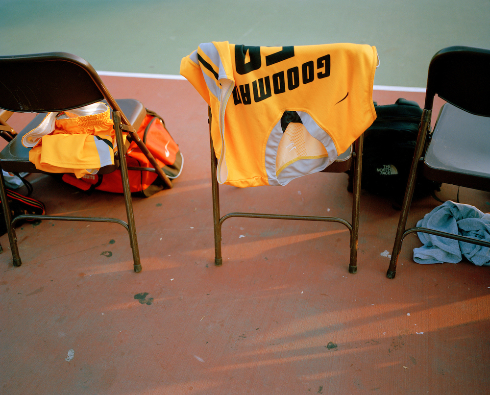 A jersey rests on a chair during warm ups before a summer 2013 George Goodman Basketball League game at Barry Farms Dwellings basketball courts in Southeast Washington, DC. Players have to change into the uniforms once they arrive at the court.