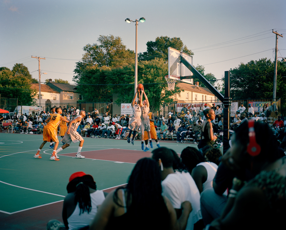 Goodman League fans take in on court action during a game at Barry Farms Dwellings basketball courts in Southeast Washington, DC.