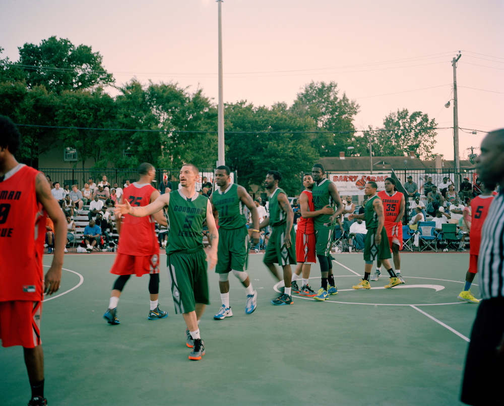 The White Chocolate All Stars and Uptown Elite shake hands after a summer 2013 George Goodman Basketball League game at Barry Farms Dwellings basketball courts in Southeast Washington, DC.