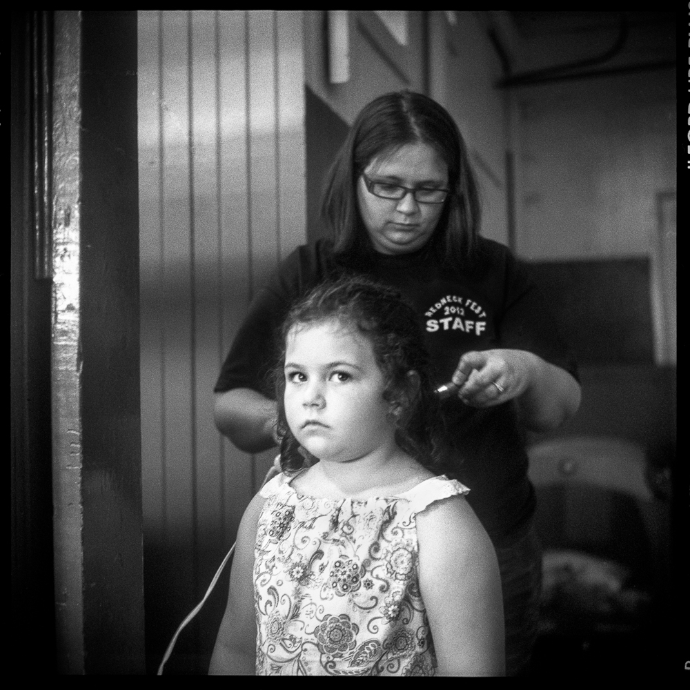 Mother fixing her daughters hair for the Miss Redneck contest, Baxterville, Mississippi