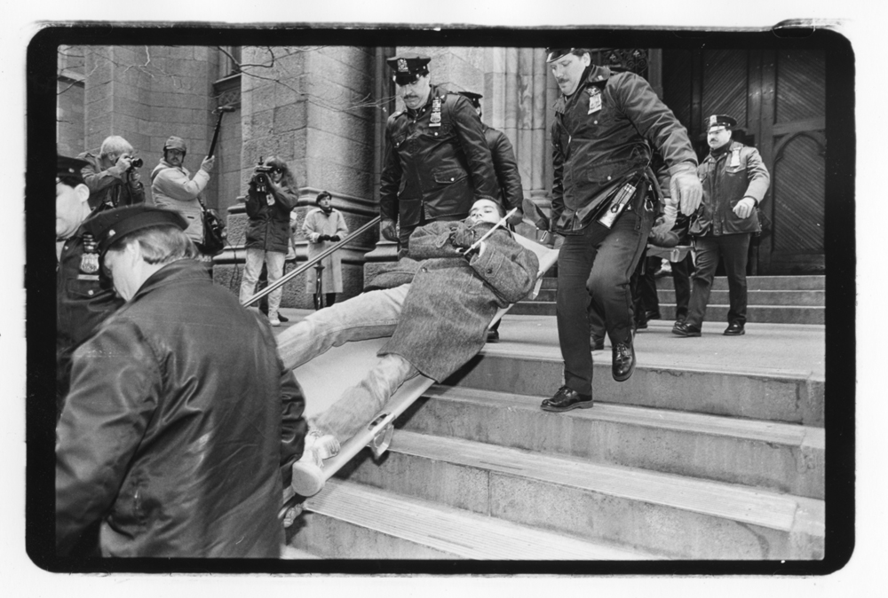 A protester is carried away during an ACT-UP Stop the Church direct action at St. Patrick's Cathedral on December 10th, 1989.© Brian Palmer