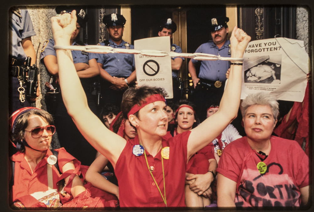 Pro-choice demonstrators in downtown Manhattan protest the July 3rd, 1989 Supreme Court Webster decision which limited Roe V Wade. This was a turning point in the pro-choice movement.  24 were arrested, including activist Mary Lou Greenberg, as they stormed the Brooklyn Bridge.  © Nina Berman