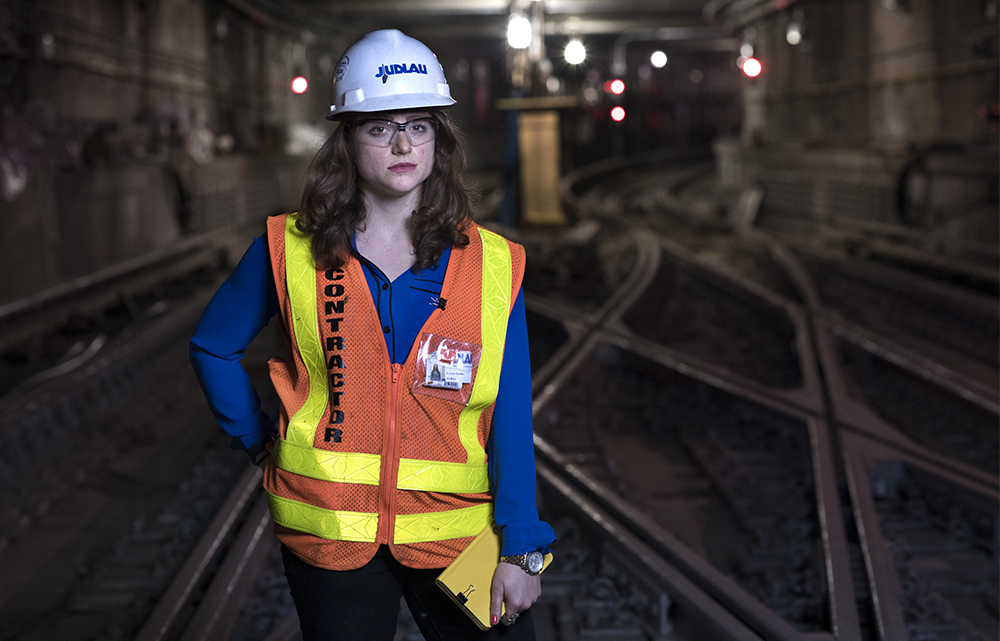 "KRISTINA IPPOLITO, a project engineer at Judlau Contracting in New York City. Kristina works on the South Ferry subway station rebuilding effort, which was damaged during Superstorm Sandy. She is the only woman engineer on the job.  ""It's a challenge to be the only woman in a male-dominated field. It takes a lot longer for men to take you seriously. You have to prove that you know something. People will ask things like, ""Whose daughter are you?"" or ""Are you an intern?"" That make you feel almost unqualified. That's the main frustration. It's about getting the job done, though. It takes a while for men to get over that hurdle, but once they do it works out."""