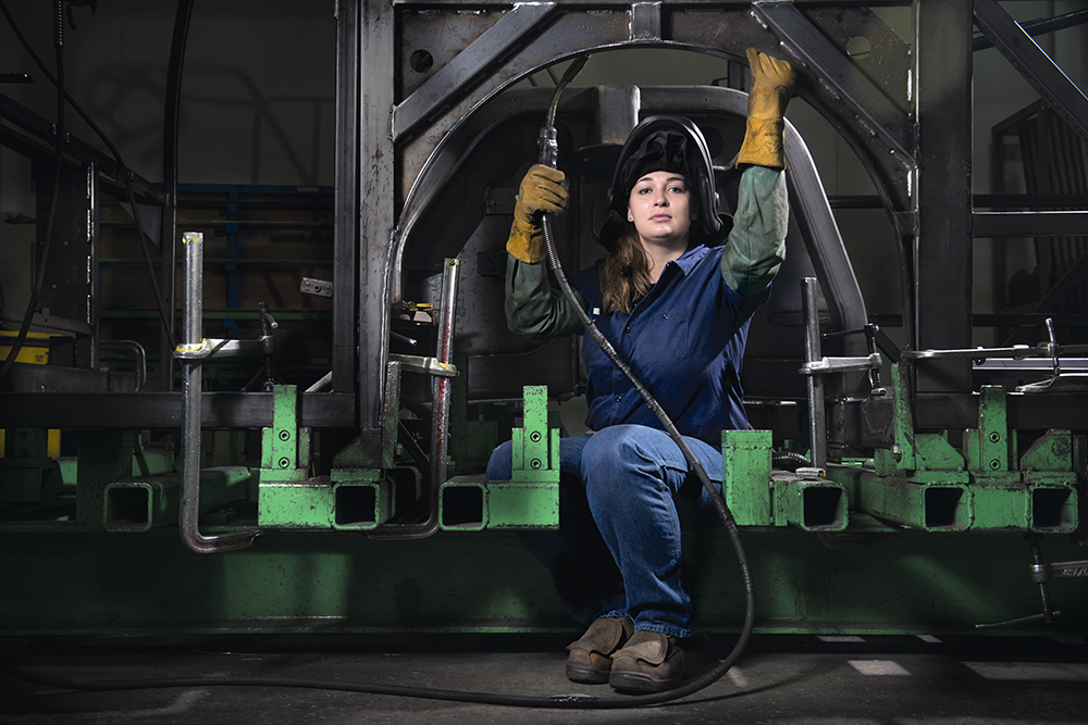 "CHANCY DAVIS, the only woman welder at the New Flyer Industries bus factory in St. Cloud, Minnesota.  ""For me personally, I can't sit behind a desk. This, along with my good attention to detail, made welding a right fit for me. There are people out there who are old-fashioned and set in their ways and think this isn't a women's field. I want to show them that people can do whatever they set their minds to by being a living example of this."""