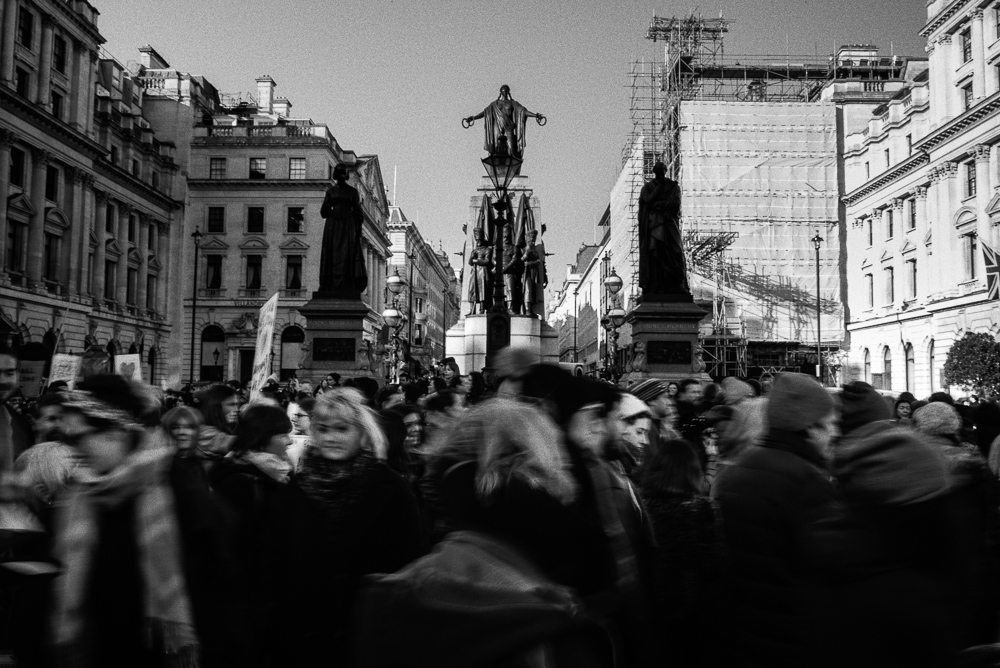 The Women's March on London makes it way past statues of Florence Nightingale, Sidney Herbert, and the allegorical figure of Victory. 21 January, 2017