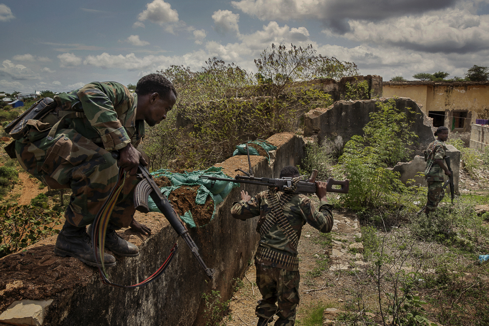 Africa, Somalia, Baidoa. 14/10/2015. Mr.Abdirashid Abdullahi Mohamed (The Governor Of Bay Region Somalia) 's escort patrol the area around the former palace of President, now completely destroyed by war. Baidoa is one of the most important cities of Somalia. In the 90's became the hardest place hit by the famine. In the 2000s it became a provisional capital of the country and in 2009 fell under the control of Al Shabaab. Since 2012 he has been freed from the AMISOM forces but remains one of the most persistently targeted Somali cities by the terrorist attacks.