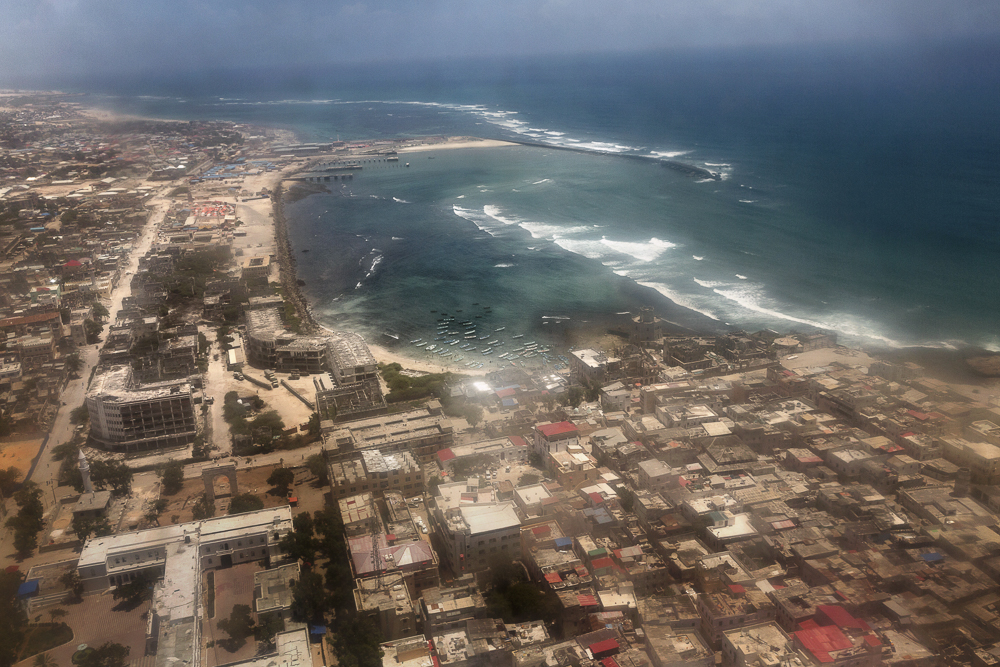 Africa, Somalia, Mogadishu. 16/10/2015. Mogadishu from above. The present of the Somali capital. Behind it, a civil war lasting 25 years; ahead of it, a future of rebirth. Mogadishu is at a crossroads. On the one side, the persistence of a surreptitious conflict based on a new, asymmetrical strategy of terror with Al-Shabaab, yet on the other, a desire for a return to normal life on the part of the Somali people, who are timidly seeking to carve out a role for themselves.